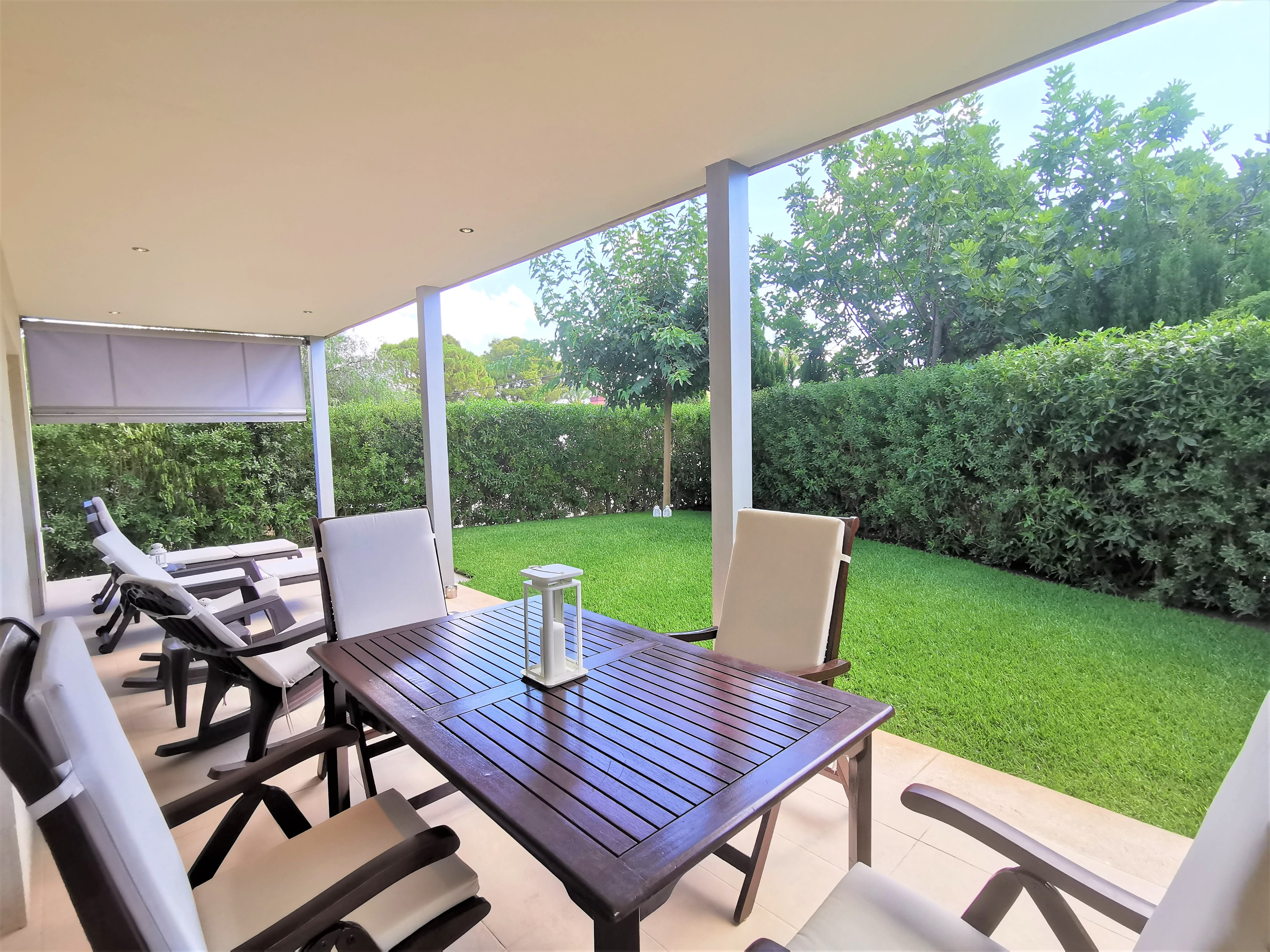 Ground floor apartment with private garden and communal pool for sale